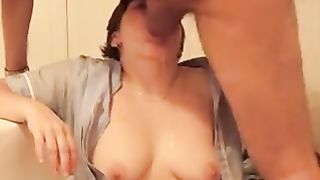 My wife takes a huge load from one of her boyfriends. You can even hear her gagging on the spunk being squirted down her throat!