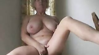 Mature wife rubbing her pussy or A mature rubs her hairy pussy