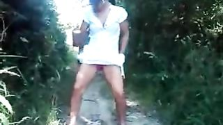 My horny amateur wife pissing in a public park