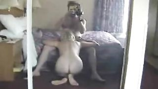 Home made video. Husband filming wife in hotel. She is real horny