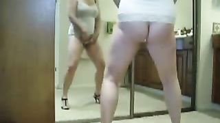 Chubby wifey in high heel shoes masturbates in front of the mirror