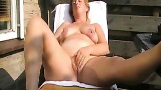Chubby white European cheating wife masturbates on the lounger