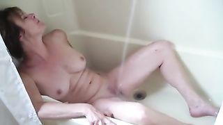 Mature and busty dirty slut wife in the washroom tub masturbating on web camera