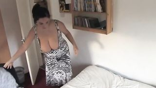 My large breasted wifey is making daybed with boobs-out