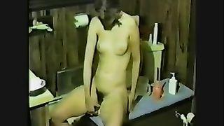 Petite white white women in the bathroom riding a dildo on home vid