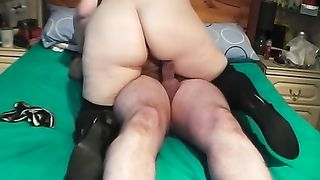 My bulky wife wearing high boots rides my wang in homemade movie scene
