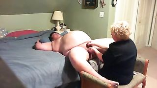 Homemade scene with my golden-haired older wife giving me a tugjob