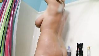 My big-breasted golden-haired horny white wife strokes her body in the shower