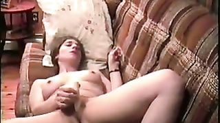 White French housewife on the daybed masturbates with a miniature sex tool