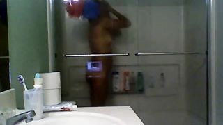 My sunburned dark brown wife takes shower on hidden webcam
