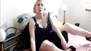 Horny golden-haired cougar wifey in couch posing sex in couch