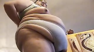 Enormous SSBBW brunette hair aged housewife puts on her pants and brassiere