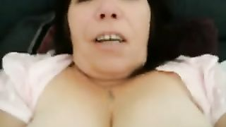 Banging mature woman's vagina in missionary position