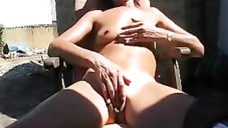 Homemade video with my slim older white women fingering her vagina outdoors