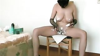 Busty milf black cock sluts in the mask shaves her cum-hole on web camera