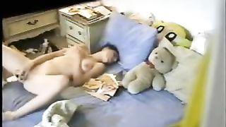 Brunette black cock sluts toys her love tunnel in front of a hidden webcam