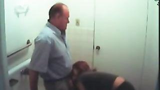 Hidden web camera clip with a excited redhead engulfing an older man's weenie