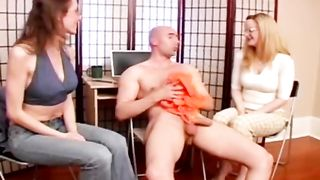 Two clothed angels work on shlong in their own massage parlor