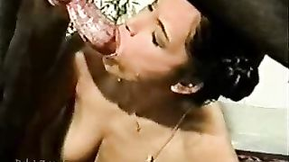 Brunette takes a dog's juice in her face hole