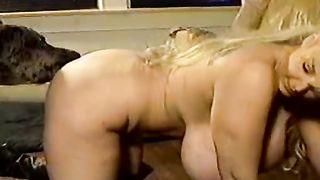 Busty blond chick bonks a nasty pooch