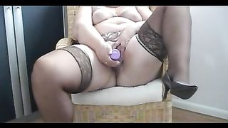 My obese hotwife wearing nylons enjoys playing with a sextoy