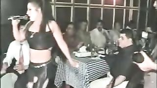 Sexy Arab dancer in her constricted pants shows of her arse and camel toe