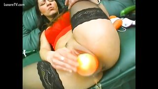 Kinky brunette hair fucking herself with objects