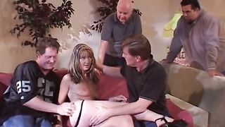 Alluring golden-haired whore with well stacked body gangbanged from behind in threesome