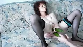 Woman fucking herself with vegetables