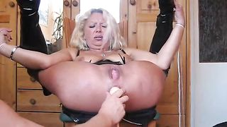 Flexible golden-haired haired MILFie nympho in high boots receives holes screwed with toy