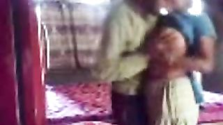 Dark haired non-professional Desi wifey in sari provides her hubby with BJ