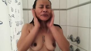 My perverted brunette hair white wife takes a shower and flashed her titties on my webcam