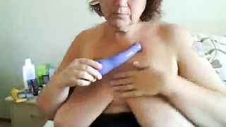 BBW pokes at her pussy with a kinky, curved vibrator