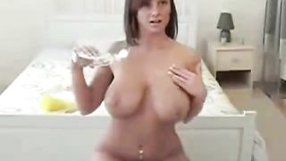 Busty brunette gets her tits oiled up for a shiny vibrator