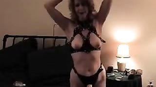 Busty wife with strapon on wits for her victim in the bedroom