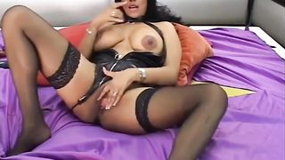 Awesome dark brown web camera wench with large milk cans masturbating