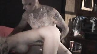 Slutty tattooed wife gives a strapon fuck and a rim job to a guy