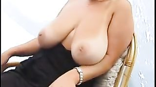 Busty brunette wife gets ready to expose her huge massive,natural, juicy jugs!