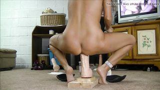 Hot brunette wife rides monster dildo, grinding a dildo against her meat flaps