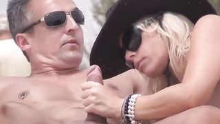 Naughty blonde wife gets a glistening facial out at the beach