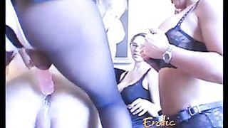 Six smoking hot ladies use strap-ons to bang a horny stud
