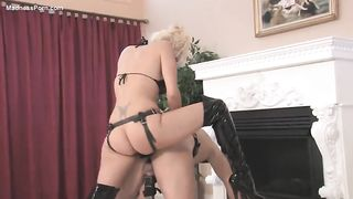 Platinum blond milf pegging a yielding guy from behind
