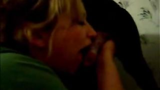 Cute excited woman is giving head to her obedient pet