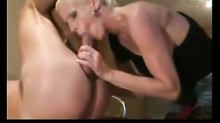 Beautiful blond cougar giving her dude a oral sex betwixt pegging his arse