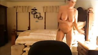 Naturally busty milf masturbates in front of a camera