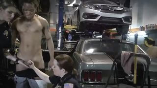 Two girls in a police uniform give a blowjob to a black dude in a garage
