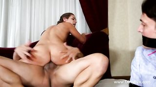 This wife has him tied and gagged with black duct tape and brings in her friend to fuck her right in front of the eyes