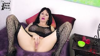 Stunning raven-haired beauty masturbates with white toy