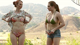 Redhead mom seduces her daughter in an outdoor pool inviting her to a lesbian play