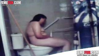 Hidden cam catches my kinky fat wife masturbating in toilet.